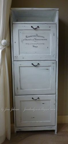 Two plywood pieces, hinged and hook at the top, drawer pull on the front, paint white and pick a cute applique and transfer