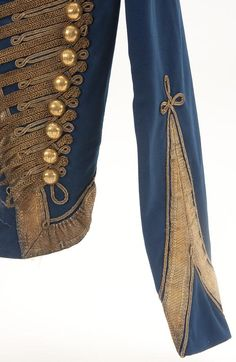 Imperial Russian Crimean War Hussar's military jacket, circa 1855, depicting the bright blue wool Attila for an officer of the 12th Regiment with gold bullion cord frogging and cuff braid.