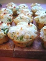 Bite-sized  muffins topped with melting cheese that are  savory, tangy, and a little bit sweet at the same time.