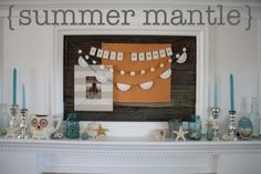 the pleated poppy:  beachy summer mantle (love the 3 buntings, buckets of sea glass and blue jars!)