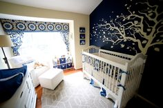 Navy and Khaki nursery. Bedding and window treatments from New Arrivals. Glider from Little Castle and crib from Newport Cottages.
