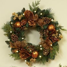 green Christmas Wreath with brown flowers and golden baubles also golden pine cones. Decorating Christmas Wreaths With Ribbon Brings Inspiration Design Outdoor Christmas Wreaths, Artificial Christmas Wreaths, Christmas Door Decorations, Xmas Wreaths, Christmas Reef, Noel Christmas, Christmas Crafts, Christmas Ornaments, Christmas Presents