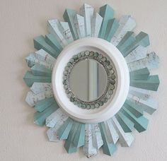 diy beaded sunburst mirror from a ceiling medallion scrapbook paper, crafts, diy, home decor, how to, wall decor, I used gorgeous scrapbook paper and beads from Michael s to create this sunburst mirror s rays see how I made them Step by step instructions included