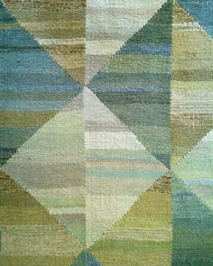 Montagne Handwoven - hand dyed, handwoven wool rug with geometric detail. Individually woven strips are sewn together to achieve an irregular, abstract design. Colors include blue, taupe, white, grey and green.