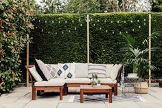 Outdoor lounge with boho global inspired accents. A paved patio area with Ikea Applaro furniture