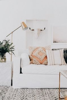 White washed luxury. Side cube and gold reading lamp.
