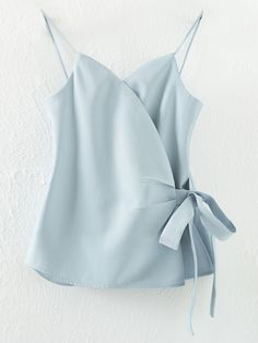 Shop Light Blue Spaghetti Strap Bow Side Wrap Cami Top online. SheIn offers Light Blue Spaghetti Strap Bow Side Wrap Cami Top & more to fit your fashionable needs.