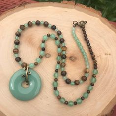 A personal favorite from my Etsy shop https://www.etsy.com/listing/529439954/tiger-eye-and-green-aventurine-necklace