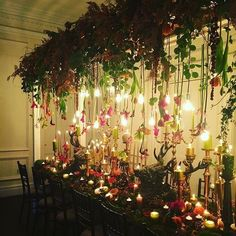 Feeling festive with this @redfloral tablescape and hanging flowers! #RedFloral #littlewhitebooks #candles #edisonbulb #autumnwedding #longtables #ashfieldhouse #redfloralarchitecture #hangingflowers #festive #winterwedding #winteriscoming #tablescape #we