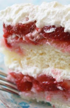 Strawberry Cake recipe from Jenny Jones (JennyCanCook.com) - A show-stopping cake made with 2 lbs of fresh berries and covered with whipped cream. Wow!!