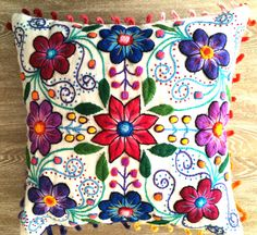 Vibrant, colorfull flowers pop beautifully from the cream background of this hand embroidered cushions. Fantastic textures of needlework from the Andes