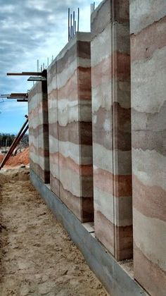 Liked on Pinterest: I think in Invercargill it would all be one colour... ;)  Rammed Earth wall @ East Cape Baja Mx. by fabriKG