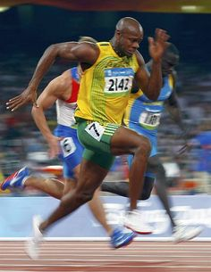 Asafa Powell of Jamaica sprints during his 100m heat in the athletics competition in the National Stadium at the Beijing 2008 Olympic Games