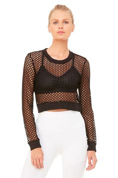 <p>Join the mesh set in the Summertime Long Sleeve Top. Cropped for the coolest finish, this open-mesh style is the best way to rock what you've got. A stylish scoop neck and cuff details complete the look.</p>