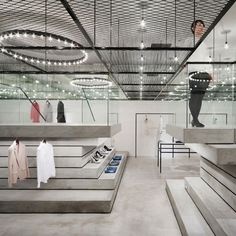 Designer Chikara Ohno of Sinato has completed the interior of a boutique in Tokyo by adding a display level above head height made of expanded metal. Called DURAS Daiba, the shop has a stepped platf..