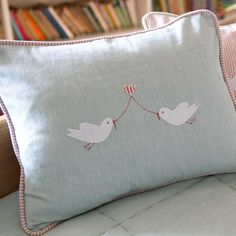 Hand embroidered duck egg blue cushion with lovebirds and heart