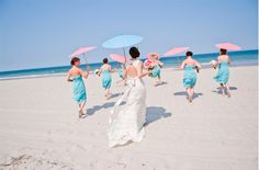 These beautiful maids stayed cool with their unique props! Brooke Mayo Photography http://www.outerbanksweddingassoc.org/membersearch/memberpage.html?MID=1832=Photographers=16