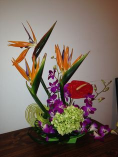 Birds of paradise, green hydrangea, anthurium and dendrobia orchid arrangement