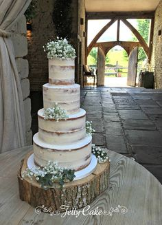 4 Tiers of vanilla and lemon cake with a thin coating of buttercream and finished with fresh gypsophila. All delivered to the gorgeous setting of Cripps Barn in the Cotswolds.