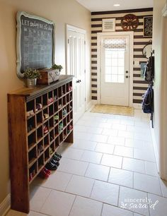 Love this mudroom area!  Blogger shows how she added the strips and made the chalkboard calendar from an old mirror. www.sincerelysarad.com
