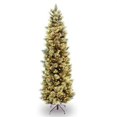 With a slim shape and a nice, pre-lit design, the Carolina Pine Artificial Christmas Tree from National Tree Company is a brilliantly festive addition to your holiday decorations. The tree features numerous clear lights and folds up for storage. Slim Artificial Christmas Trees, Slim Christmas Tree, Beautiful Christmas Trees, Artificial Tree, White Christmas, Cozy Christmas, Modern Christmas, Christmas Holiday, Holiday Fun
