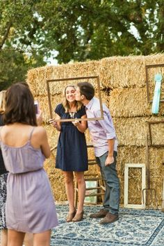 Stack some hay bales, hang up some vintage frames and put those  ribbon medallions to use for a DIY wedding photo booth backdrop that flaunts country chic style. Major bonus points for including ribbons you've won at a state fair.