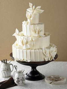 This all white wedding cake is cover in fondant pleats of ivory chocolate.
