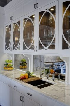 kitchens - white kitchen cabinets marble countertops polished nickel bridge faucet antique mirrored backsplash Gorgeous kitchen with white kitchen