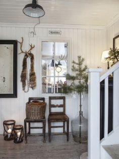 Just like this...the antler in the hook, the idea of a branch in the giant glass bottle, the lanterns on the floor...
