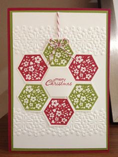 Stampin' Up! ... handmade Christmas card brom Oakfield Crafts ... Six Sided Sampler and Hexagon punch used to creat a simple wreath ornament ... bands of embossing folder texture run across the card background ... folkloric quilt look from flower pattern in flowers ... luv it!