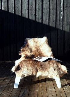 Love the fur thrown over the simple, ikea outdoor chair. Lovely!