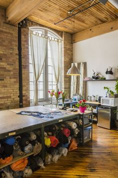 Sewing Studio Inspiration - The Sewing Rabbit - MICHI sassy fashion studio. LOVE LOVE LOVE the table with rolls of fabric underneath. Showroom Design, Interior Design, Studio Interior, Room Interior, Studio Table, Workspace Design, Sewing Rooms, Sewing Room Design, Sewing Spaces