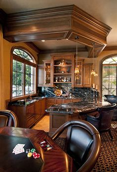 like the architectural ceiling section holding pendants. Gives structure to the otherwise open kitchen.