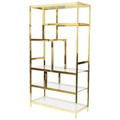 Midcentury Brass Etagere Display Shelf Unit | From a unique collection of antique and modern shelves at https://www.1stdibs.com/furniture/storage-case-pieces/shelves/