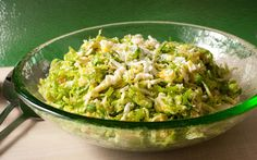 This shaved Brussels sprouts slaw recipe tosses thinly sliced raw Brussels sprouts with hard-boiled eggs and a tangy Dijon dressing.
