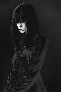 Kind of reminds me of a grown-up Lydia Deetz in the velvet #Goth coat and long over face hair