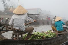 Fruit sellers, Cai Rang floating market, near Can Tho, Vietnam