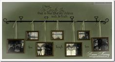 Hang pictures on a curtain rod using ribbon.