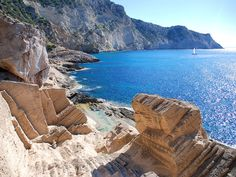 Down the beaten path of the western coast of Ibiza sits the Lost City of Atlantis, a remote and mystical place which is considered the gem of the Island. Menorca, Ibiza Formentera, Atlantis, Ibiza Town, Ibiza Beach, Places To Travel, Places To Visit, Travel Destinations, Ibiza Travel