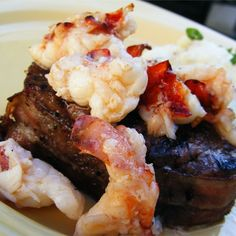 Bacon-wrapped filet mignons are broiled and topped with lobster meat for a very special dinner. Elegant for dinner parties or a romantic dinner for two. If you desire crabmeat instead of lobster, go for it! Lobster Recipes, Fish Recipes, Seafood Recipes, Beef Recipes, Dinner Recipes, Cooking Recipes, Cooking Tips, Dinner Ideas, Recipies