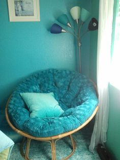 Papasan chair and $20 lamp from Target. The lamp is flexible so we posed it to look like a peacock tail.
