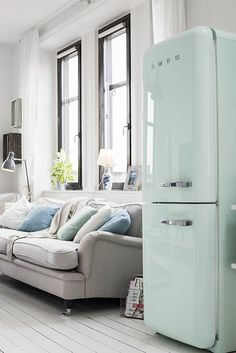 Pastel green smeg in a charming one room Swedish apartment