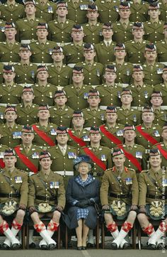 Queen Elizabeth and her Troops - someone forgot to tell the fellow to the left to tuck his kilt down a bit more!
