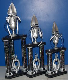Silver and Black Boat Race Trophies