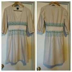 Cynthia Rowley Midi Dress This dress has pretty detail on the waist area.Deep V neckline.Pockets in the front and side zipper closure.It has 3/4 sleeves that has elastic. Excellent used condition. Cynthia Rowley Dresses Midi