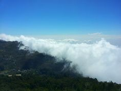 Huge mountain clouds slowly engulfing a sleepy town in the valley @ kodaikanal india