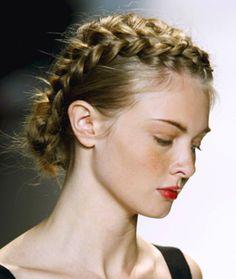 ....feminine frocks her safari theme influenced the hair at her show