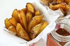 Baked Spicy Garlic Potato Wedges - crunchy on the outside and soft on the inside with a slightly spicy and garlicky flavor.
