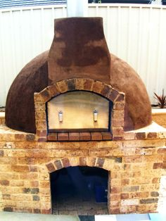 Rendered and exposed brick Pizza oven