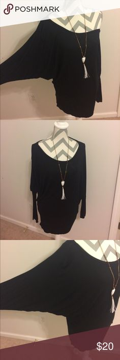 Black tunic top EUC, worn a handful of times. Dolman style and tighter at the bottom. Purchased from a local boutique. Perfect to pair with tights! Very stretchy and comfortable. Offers welcome. Be sure to bundle & save! Tops Tunics